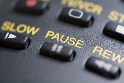 3080279-a-close-up-of-the-pause-button-on-a-remote-control.jpg